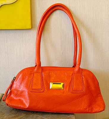 A bright red orange red bag goes with everything!